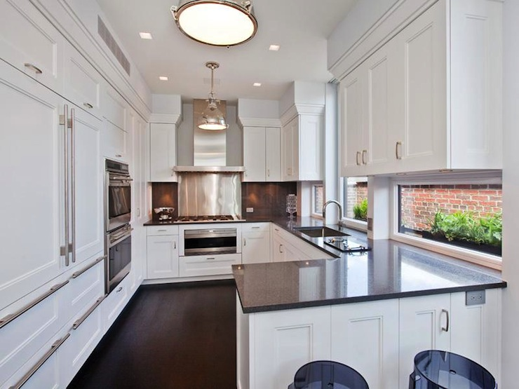 kitchen with creamy white shaker cabinets grey quartz countertops grey