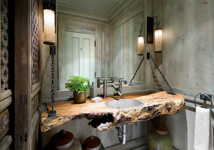 Rustic Bathroom With Wood Paneled Walls And Hanging Driftwood Sink Vanity  Secured By Chains As Wellas Modern Faucet.