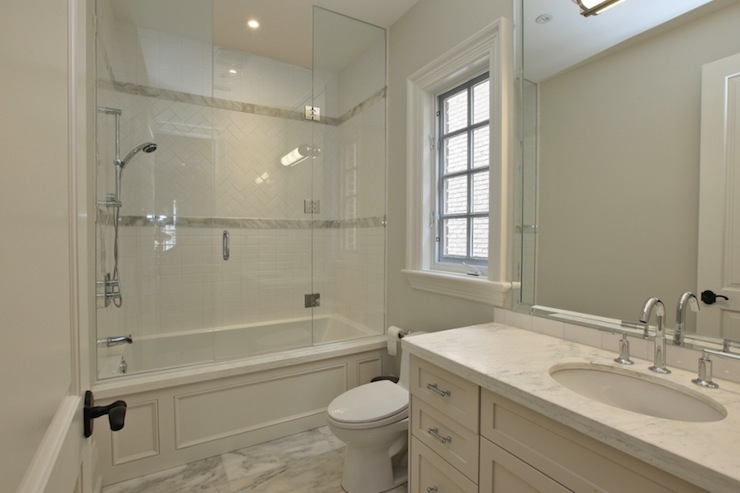View Full Size Small Bathroom With Seamless Glass Shower Door Over Wood Paneled Drop In Tub Herringbone Subway Tile