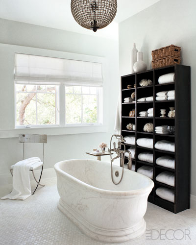 ... With Satin Nickel Tub Filler, White Carra Marble Hex Tile Floor, Pale  Gray Walls, Chrome Bathroom Chair And Glossy Black Bathroom Cabinet. Elle  Decor