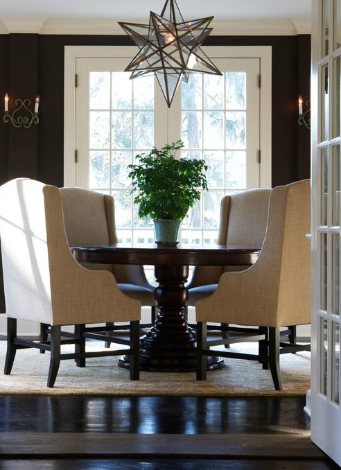 Elegant dining room with chocolate brown walls  French doors  chocolate  brown pedestal dining table  camel linen dining chairs and Moravian star  pendant Moravian Star Pendant Design Ideas. Moravian Star Pendant Light Fixture. Home Design Ideas