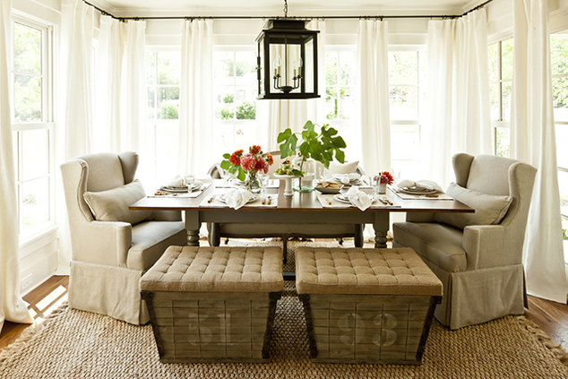 Chic Cottage Dining Room With French Burlap Storage Ottomans Seagrass Rug Taupe Gray Table Turned Legs Linen Wingback Slipcovered Captain