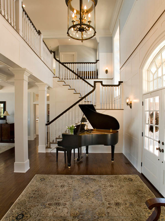 Foyer piano traditional entrance foyer mitch wise design for Traditional beach house designs