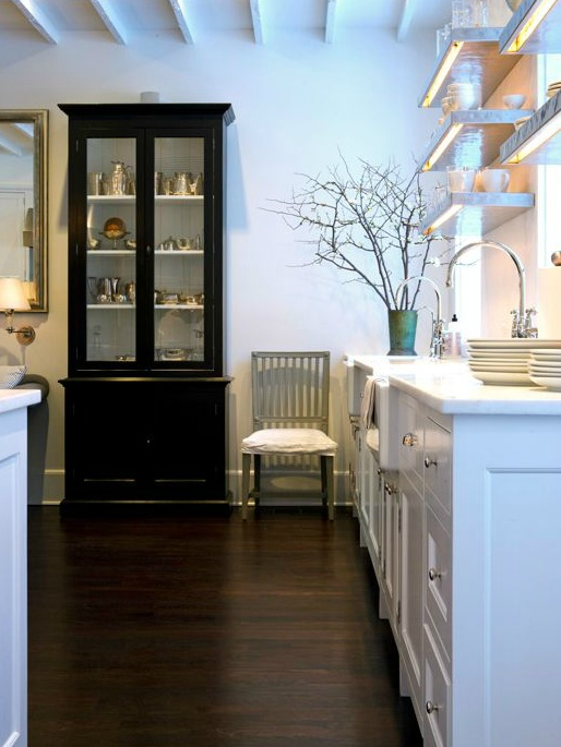 Lovely Kitchen With Black Glass Front China Cabinet, White Cabinets With  White Marble Countertops, Farmhouse Sink And Stainless Steel Floating  Shelves.