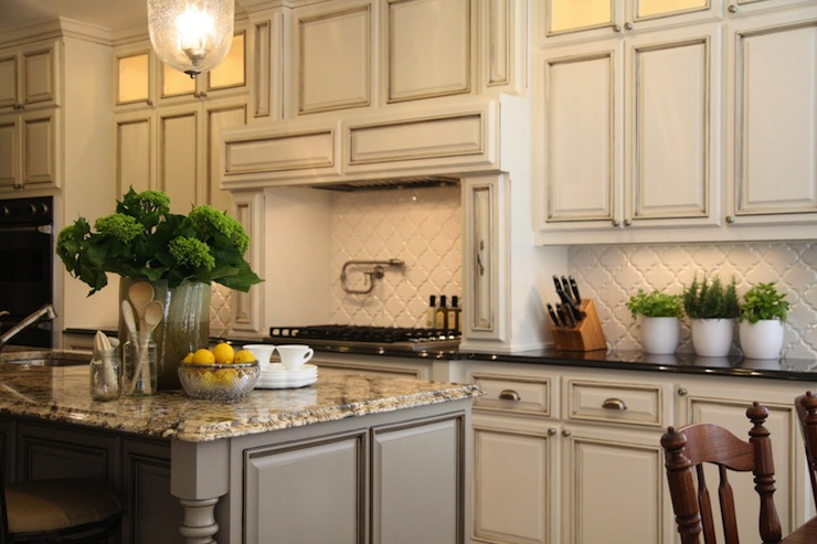 ivory kitchen cabinets with gray granite countertops transitional