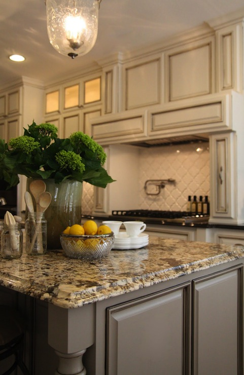 Gold granite countertops transitional kitchen m e for Antique ivory kitchen cabinets
