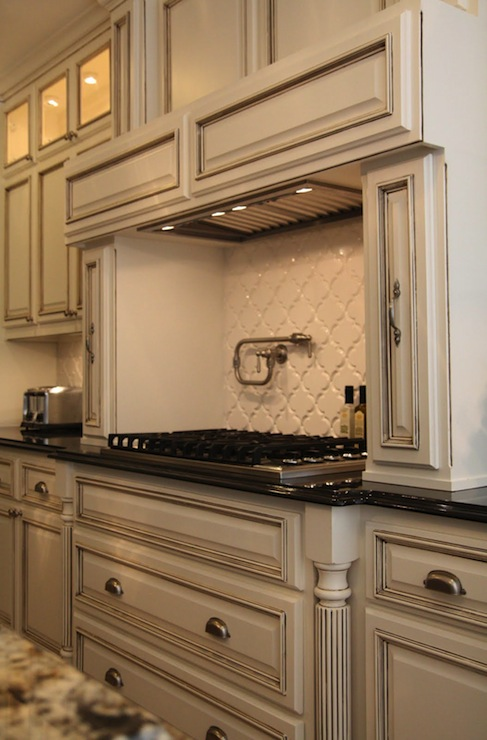 Gray granite countertops transitional kitchen davies for Antique glazed kitchen cabinets