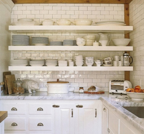 subway tiles backsplash and stacked white floating shelves filled