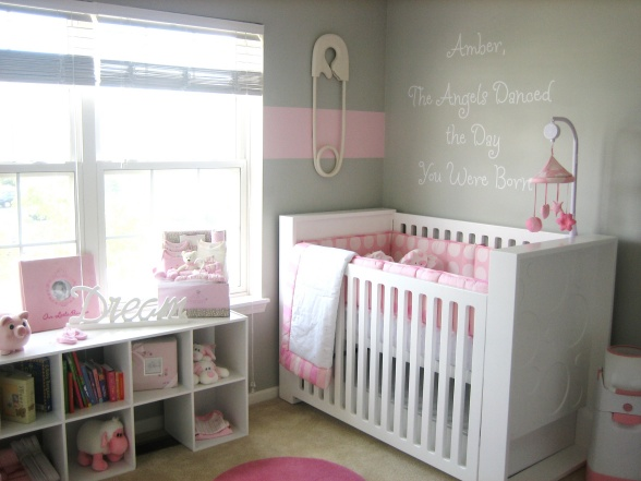 Adorable pink and gray nursery design with gray walls, giant safety pin  wall art, white modern crib with pink crib bumper, pink crib mobile and  white ...