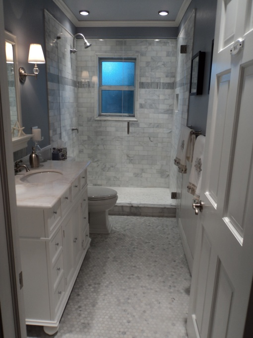 Amazing Bathroom With Blue Walls White Carrara Marble Hex Tile Floor White Single Vanity With Marble Top White Mirror With Shelf Robert Abbey Muse One