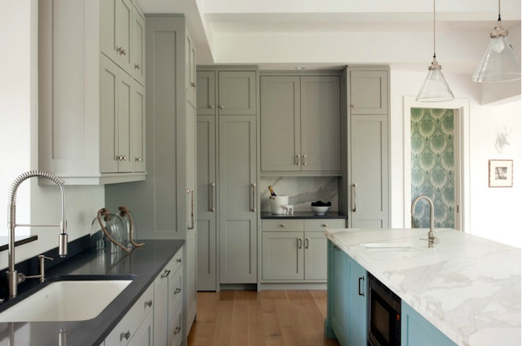 Turquoise and gray kitchen with gray cabinets with black countertops