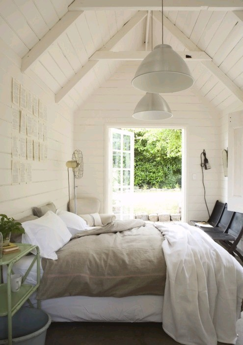 comfy cozy bedroom design with white wood paneling vaulted ceiling