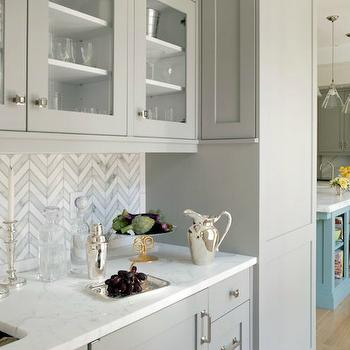 Butler's pantry with herringbone backsplash and gray glass-front shaker cabinets, Contemporary Kitchen, Liz Caan Interiors