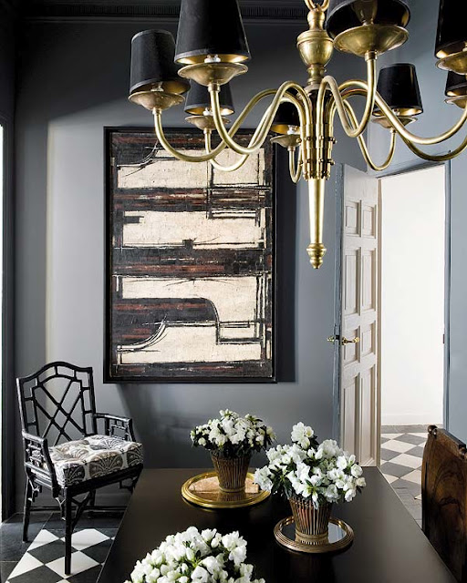 Blue And Black Dining Room With Walls Abstract Art Antique Brass Chandelier Shades Faux Bamboo Chairs