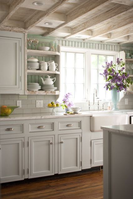 Cottage kitchen with seafoam green painted beadboard backsplash, white  cabinets with white marble countertops, subway tile backsplash, farmhouse  sink, ...