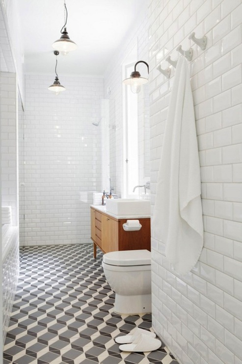 modern bathroom with beveled subway tiled walls repurposed mid