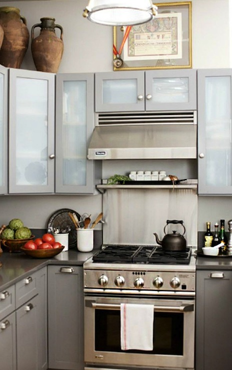 Modern Gray Kitchen With Gray Lacquer Upper Cabinets With Frosted Glass  Doors, Gray Shaker Lower Cabinets, Gray Quartz Countertops, Small Stainless  Steel ...