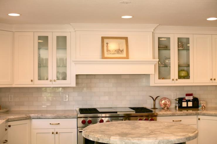 white quartzite countertops and thassos marble subway tile backsplash