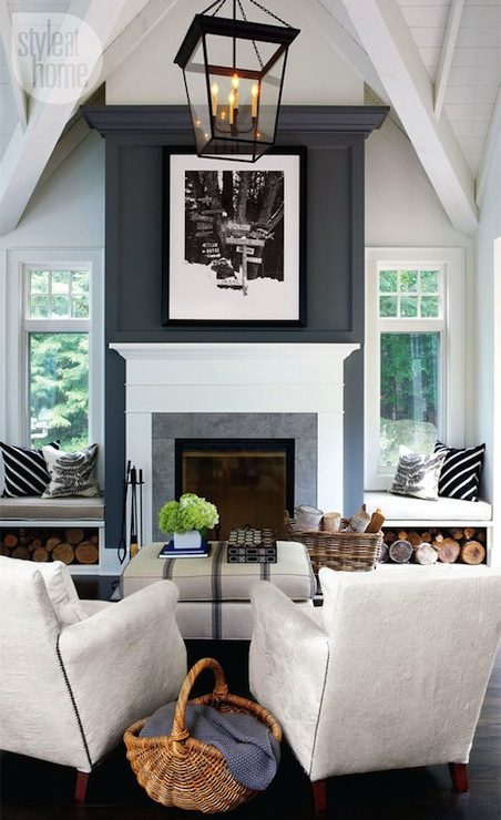 Amazing Living Room With Vaulted Ceiling Built In Window Seats Flanking Fireplace Shelves For Firewood Blue Wall Iron Lantern