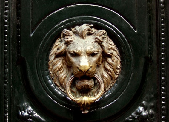 Glossy black front door with brass lion door knocker. - Antique Silver Seashell Monogram Door Knocker