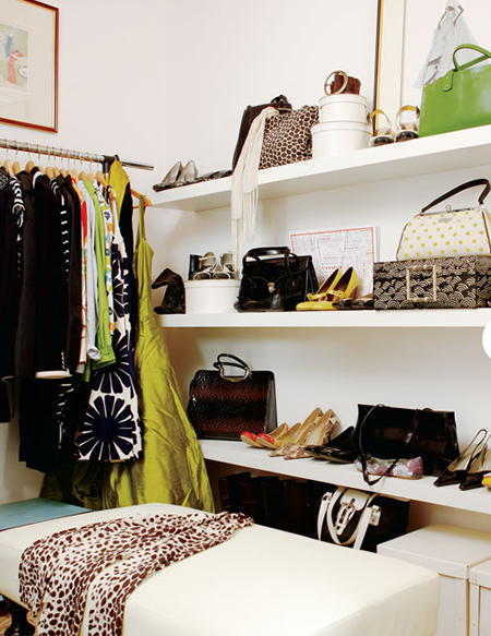 Chic Closet Design With Stacked White Floating Shelves For Shoes And Bags,  Ivory Leather Ottoman And Clothes Rack.
