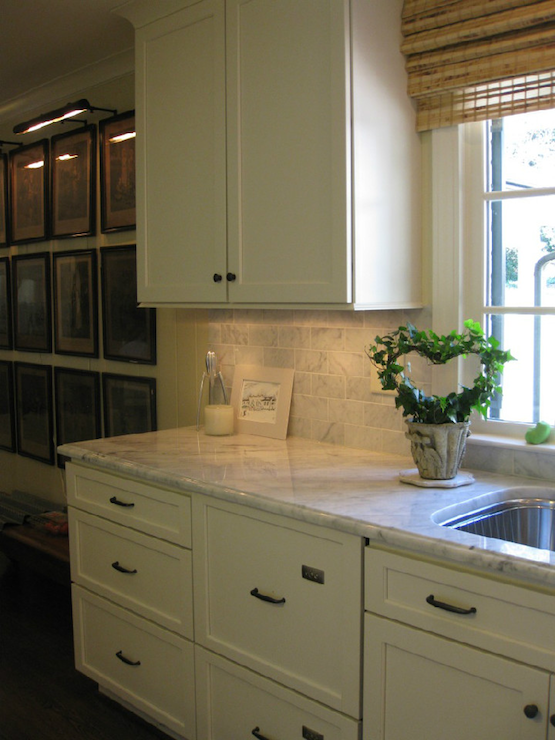 Creamy white shaker kitchen cabinets with oil rubbed bronze hardware