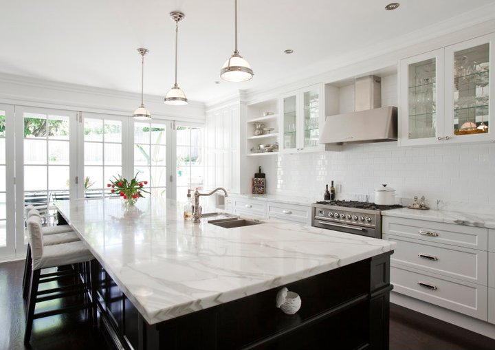 Transitional kitchen - White kitchen with dark island ...