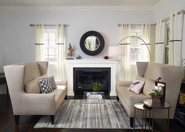 Lovely Living Room With Lilac Blue Walls Paint Color Black Convex Fireplace Mirror Flanked By Windows Covered In Ivory Grommet Drapes