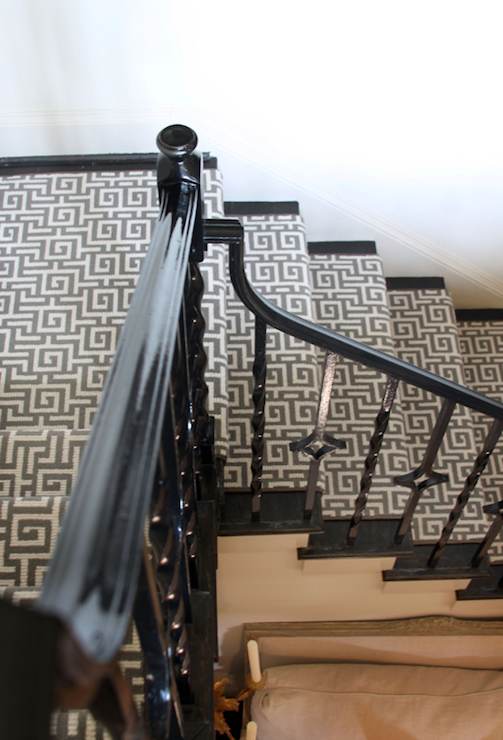 Stairwell With Glossy Black Iron Spindles And Staircase Banister And Gray  Greek Key Pattern Stair Runner.
