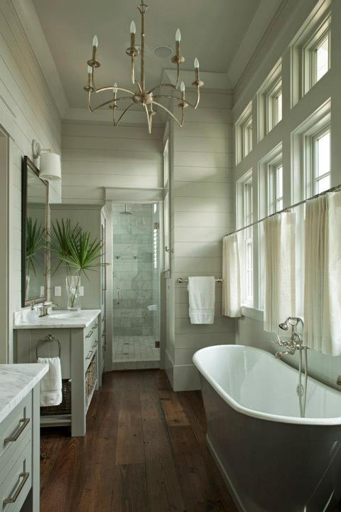 gray bathroom with gray plank wall paneling with white crown molding