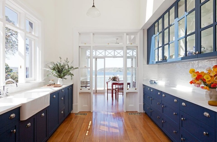gorgeous blue galley kitchen with cobalt blue cabinets glass front upper kitchen cabinets and cobalt blue inset base kitchen cabinets paired with marble - Blue Kitchen Cabinets