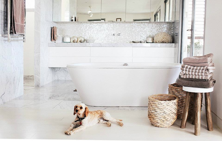 Beautiful Bathroom With Modern Freestanding Tub Rustic Stool Mauve And Gray Towels Puppy