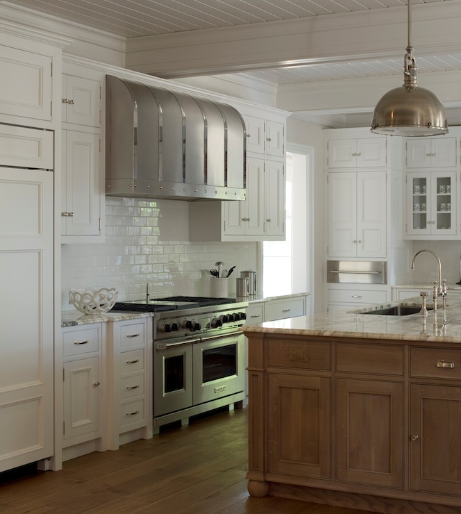kitchen with white floor to ceiling cabinets and warm brown oak island