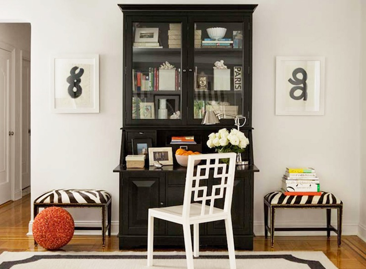 Chic Living Room Office Area With Glossy Black Secretaire Desk Glass Doors And White West Elm Overlapping Squares Chair
