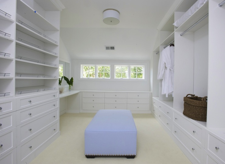 Huge Walk In Closet With White Built Shelves And Cabinets Vanity Rectangular Blue Ottoman Silver Nailhead Trim