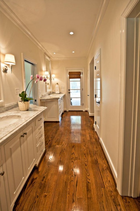 Long Narrow Master Bathroom With Cream Paint Color And Glossy White Bathroom Crown Molding