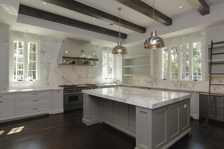 gray kitchen with polished nickel pendants over gray kitchen island