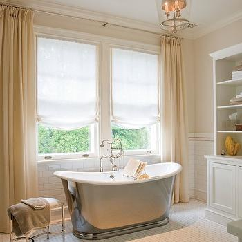 Silver bathtub in front of factory windows transitional for Peach tile bathroom ideas
