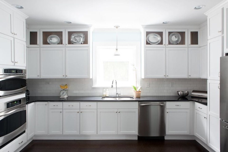 White Kitchen Cabinets With Black Countertops Transitional