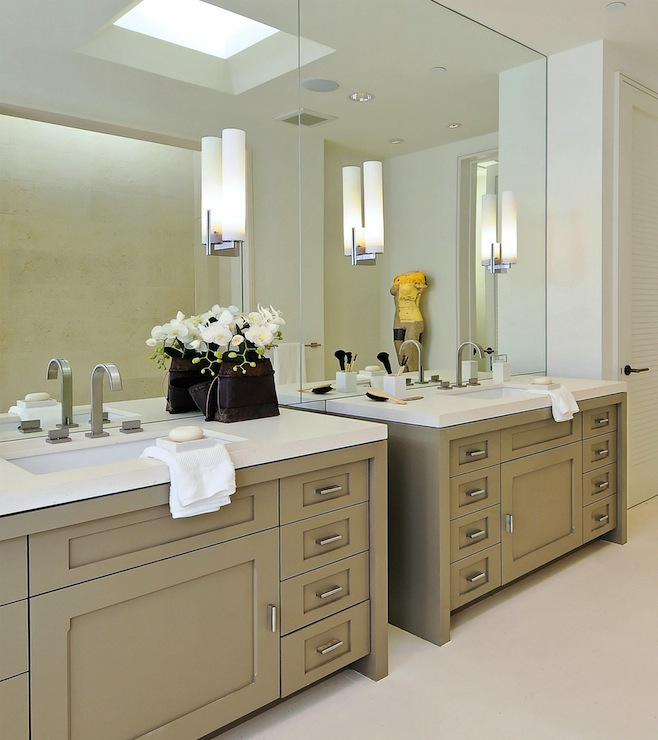 Fantastic contemporary bathroom design  Mirrored vanity wall with nickel  sconces  Bathroom with taupe cabinets with white quartz counters. White Bathroom Cabinets Design Ideas