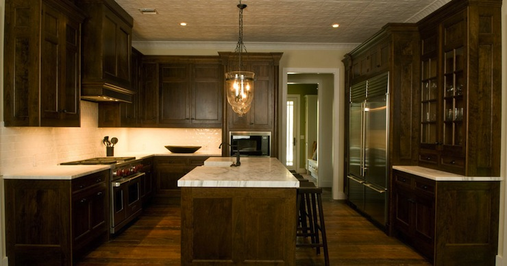 Traditional kitchen with coffee stained maple kitchen cabinets paired