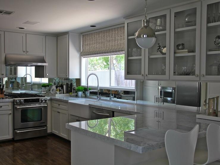 Mirror backsplash contemporary kitchen kristen nix for Mirror kitchen backsplash