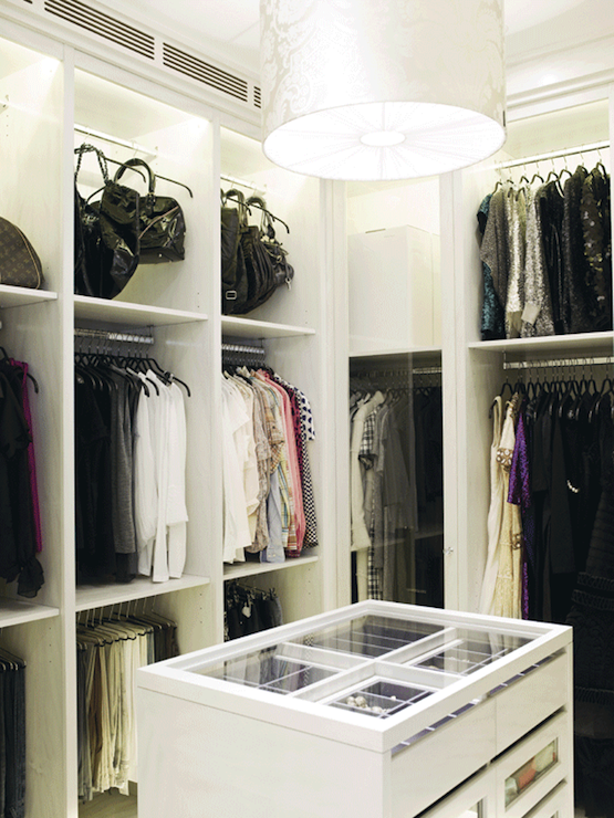 Charmant Walk In Closet With Silver Damask Drum Pendant, Built In Cabinets, Bag  Racks And Closet Island.
