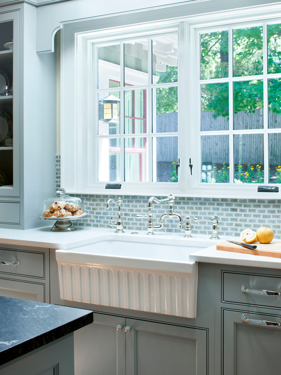 Pretty French Blue Kitchen Cabinetry And Tiled Backsplash Fluted Farmhouse Sink Vintage Style Faucets White Countertops