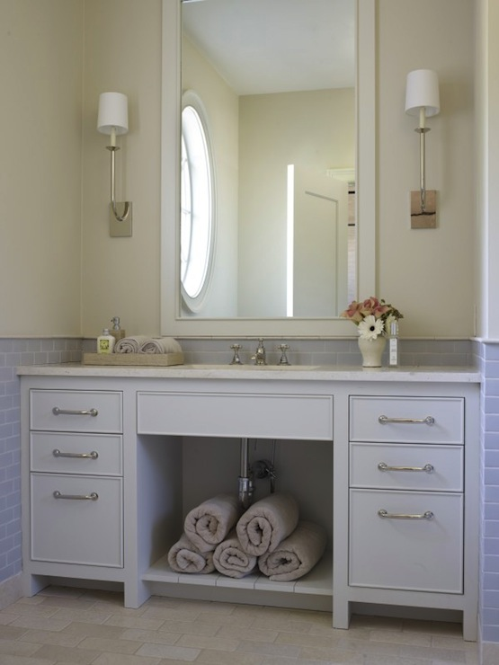 elegant bathroom with white framed mirror flanked by polished nickel sconces paired with extra wide white bathroom vanity with marble countertop - Bathroom Subway Tile Backsplash