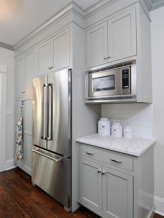 with floor to ceiling gray kitchen cabinets painted Benjamin Moore