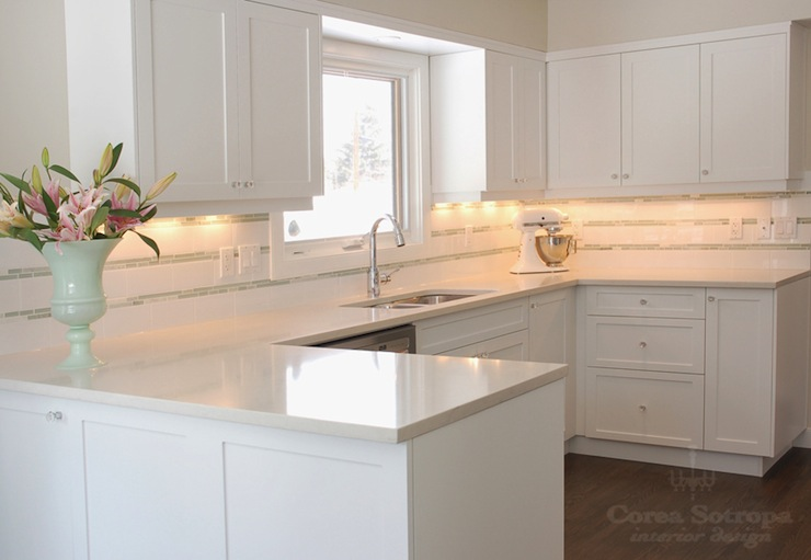 white shaker cabinets paired with white quartz countertops and white
