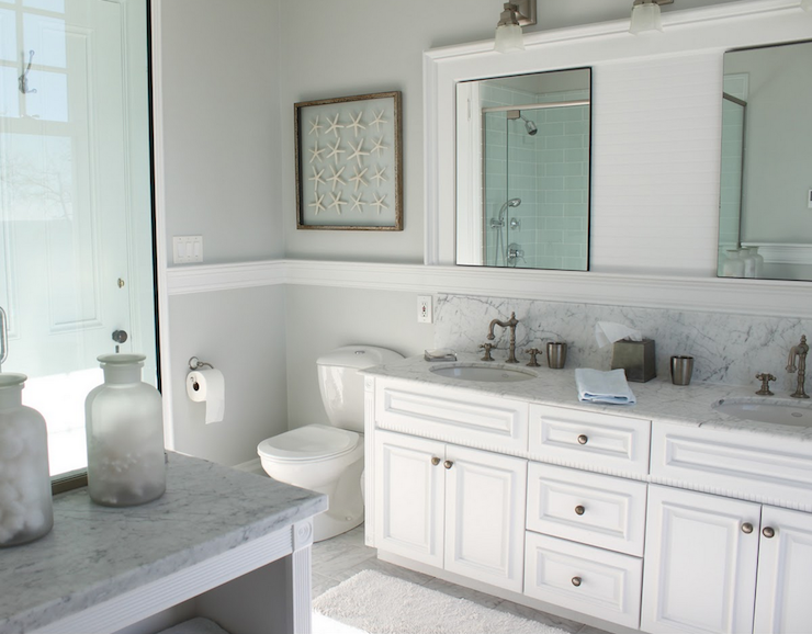 Beachy Bathroom With Pale Gray Wall Color With Framed Starfish Artwork And  Thick White Chair Rail Molding.