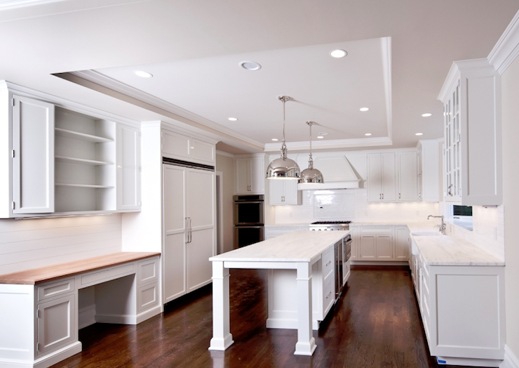 Modern L Shaped White Kitchen With Recessed Lighting Installed On Perimeter  Of Tray Ceiling.