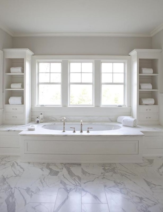 Master Bathroom With White Wood Paneled Drop Tub Flanked